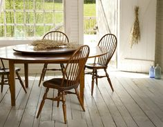 Distinct Rustic Round Dining Table with BuiltIn Lazy Susan For