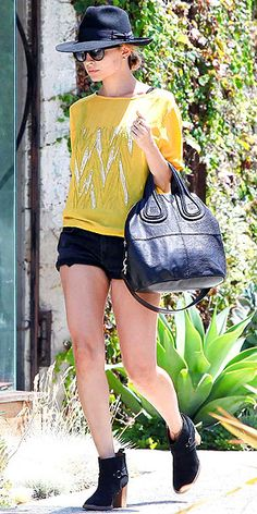 NICOLE RICHIE  Nicole does effortless cool better than anyone in Hollywood. Case in point: She runs errands in super-short black cutoffs with a cool yellow top, plus chic ankle boots, an oversize black bag and wide-brim hat.