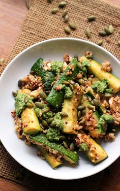 Perfect for a day in the sun, this roasted zucchini and quinoa bowl is tossed with tangy feta and a bright and tangy cilantro pepita pesto to make a great light meal.