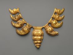 Necklace Comprising Nine Leaf-Shaped Pendants  Period: late Central Javanese period Date: second half of the 9th–first quarter of the 10th century Culture: Indonesia (Java) Medium: Gold Dimensions: H. 1 1/8 in. (2.9 cm); W. 5 in. (12.7 cm); L. 15 1/4 in. (38.7 cm) Classification: Jewelry
