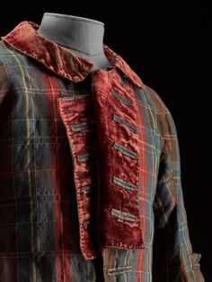 Short tartan frock coat with velvet collar and cuffs and lined in wool twill and linen, supposedly belonged to Bonnie Prince Charlie: mid 18th century.