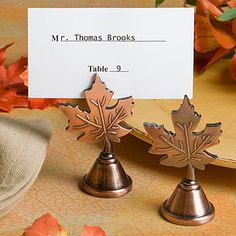 """Autumn leaf design placecard holder favors Celebrate the beauty of fall with these autumn leaf design placecard/photo holder favor Who can resist the allure of the fall? At Fashioncraft, we certainly can't! And that's why we offer exceptional favors, like these autumn leaf design placecard holders, that truly reflect the spectacular nature of the fall season. A popular choice as favors for fall weddings, showers, galas and more, we guarantee that no one will """"leave"""" this leaf behind! Descript..."""