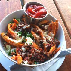 Loaded sweet potato fries from Company Cafe in Dallas...this just links to a picture.  But here is what is on the fries:  white cheddar, bacon, green onion, and fresh jalepeno.  It turned out great. I would switch out for a different kind of cheese though. Will def make again!