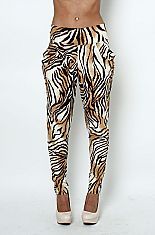 High waist tiger print loose skinny pantsThese stretchy animal print pants feature a high waist band, two side pockets, and loose crotch with fitted skinny ankles. Be fierce and fun with these hot pants!90% POLYESTER 10% SPANDEXHAND WASH COLDDO NOT BLEACHHANG DRY