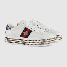 $1,250.00 GUCCI - Gucci Ace sneaker with crystals - sold by GUCCI - affiliate - The retro inspired design of the Ace sneaker is set on a platform rubber sole embellished with rows of crystals.White leather with blue and red Web detail on the sides Women's Crystals trim along the platform Red metallic leather detail on the back of one shoe and blue metallic leather detail on the back of the other shoe Rubber sole Made in Italy.