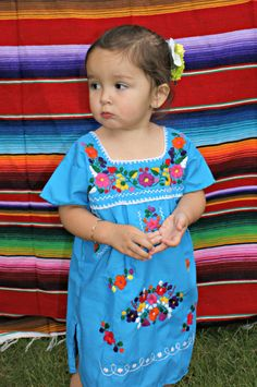 Turquoise Traditional Puebla Mexican DressHandmade Embroidered Each dress has a unique pattern and colors embroider Light weight CottonMade to be worn loose and at least knee length