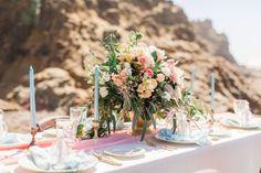 cheerful wedding centerpiece on beach wedding tablescape
