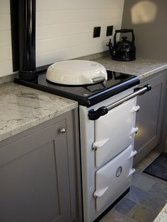 Otters Narrowboat Boat Hire on the Lancaster Canal: Tiny Aga!: How cute is that, who know they came the perfect size. Living On A Boat, Tiny Living, Narrowboat Holidays, Canal Boat Interior, Aga Kitchen, Narrowboat Interiors, Dutch Barge, Houseboat Living, Boat Hire
