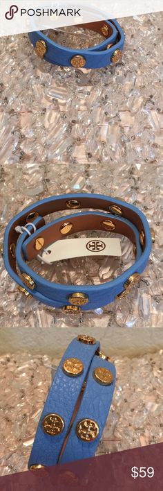 TORY BURCH DOUBLE WRAP Logo BRACELET NEW w tag TORY BURCH Stunning NEW w tag double wrap bracelet , most popular piece of TORY Jewelry. Fresh blue, perfect w/ denim, casual or dressy with gold jewelry and black dress. LEather in Periwinkle ish blue, w/ gold  T logos,  PERFECT come w velvet pouch. Tory Burch Jewelry Bracelets