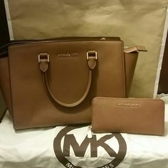 Michael Kors Purse and Wallet Authentic. Still in very good condition. Purse was rarely used. Comes with a dust bag and MK paper bag. Michael Kors Bags