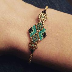 Inspiration only: Gold, blue and black bracelet.
