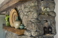The stone fire place has plenty of nooks and crannies to display the owners' handmade jewellery.