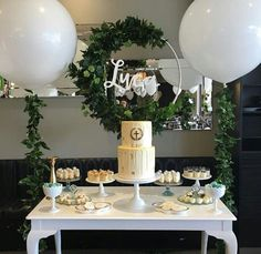The perfect greenery baby shower, gender neutral baby shower, or rustic baby shower, love the huge balloons!