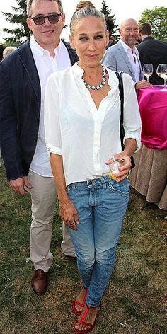 Sarah Jessica Parker looks casual chic in a white button-down blouse, a pair of light-wash jeans and red strappy sandals at the Hayground Chefs Dinner in Bridgehampton, N.Y.