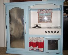 Turn an entertainment center into a kids' play kitchen!