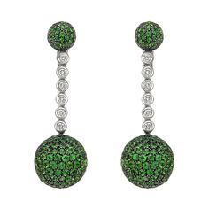 "de Grisogono Tsavorite and Diamond Drop Earrings, Drop earrings, designed with a larger pavé green tsavorite 'ball' (22mm diameter) suspended from a chain of bezel-set diamonds to a half domed pavé green tsavorite top, the earring tops and bottoms mounted in oxidized 18k white gold with the central diamond chain section and backs mounted in 18k white gold, with clips, signed de Grisogono. 2.5"" length."