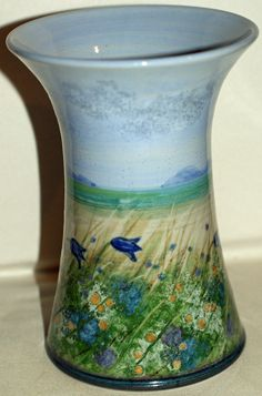 Highland Stoneware Free-Hand Painted Vase   Beautiful Highland Stoneware vase, free-hand painted with a beautiful landscape scene of flowers, beach, water and sky.   Signed underneath.  18 cms  Good condition SOLD