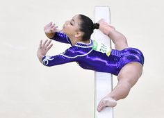 TOPSHOT - Brazil's Flavia Saraiva competes in the women's balance beam event final of the Artistic Gymnastics at the Olympic Arena during the Rio 2016 Olympic Games in Rio de Janeiro on August 15, 2016. / AFP / Ben STANSALL (Photo credit should read BEN STANSALL/AFP/Getty Images)