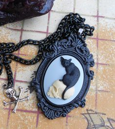 Black Cat and skull Necklace  Cameo by LEBEAUTYEXORCIST on Etsy, $20.00