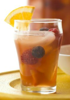Peachy Iced Tea Sangria — A fruity twist on iced tea, this recipe is packed with delicious summer berries and peaches and ready to serve in just 10 minutes.