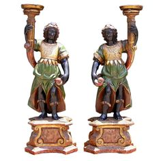 Pair of Italian Blackamore Torchieres | From a unique collection of antique and modern candleholders and candelabra at http://www.1stdibs.com/furniture/lighting/candleholders-candelabra/
