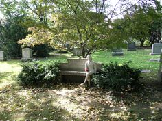 Woodlawn Cemetery - New York City, New York - Remembrance   Sometimes, the graves of the common people are the most poignant. Her son died as a young boy. The mother built this bench and statue. She came and visited his grave at least once a week until she too died. She is buried beside him.