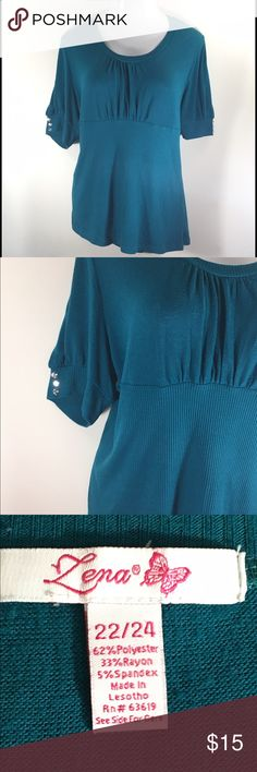 PLUS Size Short Sleeve Blouse Lena Womens PLUS Short Sleeve Sweater Blouse Top Shirt with Sparkling Buttons on Sleeves  Teal  Size 22/24  Gently Used - No Flaws Found Upon Inspection and Photographing - See Photographs for Description  Measurements Taken with Garment Lying Flat:  Bust 50 Inches (Measured Across then Doubled)  Waist 43 Inches (Measured Across then Doubled)  Front Length 28 Inches   Smoke Free, Pet Friendly   Thank you for looking! Lena Tops Blouses