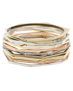 With nine bangle bracelets to choose from, the Aubrey bangle bracelet set by Kendra Scott in mixed metals makes is easy to mix and match this Fall.