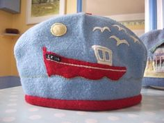 Wool teacosy made from upcycled vintage textile, with Rye fishing boat