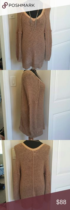 Free People Oversized Wide Knit Boyfriend Sweater Absolutely gorgeous and soft long cozy sweater from free people. Perfect for fall and winter and stunning with leggings or skinny jeans. Wide knit style shows the tank or bralette you rock underneath. No flaws! Tagged Sz M but  an fit an L due to oversized style. Feel free to make an offer! Free People Sweaters