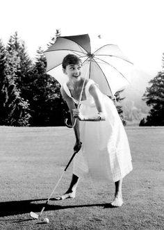 Audrey Hepburn:  golfing with an umbrella?? Audrey makes it look like that's exactly how it's done :)