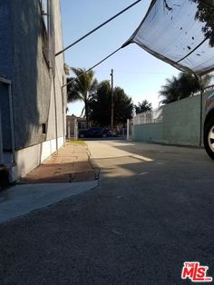 Home features 2 bedrooms, one bath, Iron fence in the front yard. Tow car detached garage, plus drive way/ RV access to park additional automobiles. Mls Listings, Los Angeles County, Detached Garage, Property For Sale, Fence, Bedrooms, Sidewalk, Real Estate, Yard