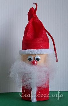 Couldn't help giggling when I saw this little guy! Paper Tube Santa Claus. That's right, he's a recycled toilet paper roll, and cute as a bug's ear. =)