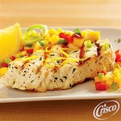 This simple and refreshing Grilled Lemon Halibut from Crisco® is sure to be a new grilling season favorite!