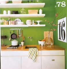 More great open shelving; kind of loving the green wall color too!