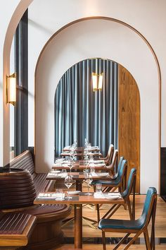Framed archways and ribbed banquette #dining #restaurant