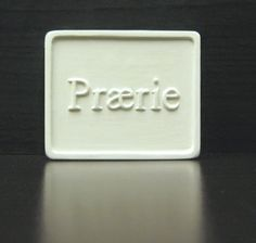 Praerie Soap Co. Soap Bar Plaster Prototype. Rectangle shape with border. Slight rounded corners, raised artwork and/or company logo. Company located in Texas, United States.