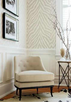 love the: wallcovering - daring. mirrored frames - edgy. wainscotting and deep baseboard trim - classy. branches in water instead of vases - mysterical. neutral colours - calming.