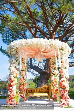 colorful floral wedding arch for traditional indian wedding