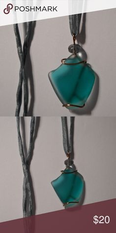 "light teal vintage glass art pendant necklace Soft, light teal color vintage glass, wrapped in bronze plated wire, and adorned with a pale blue faceted glass bead. 1 3/4""h x 1""w. With a grey blue silk string that is 36"" long klinsky Jewelry Necklaces"