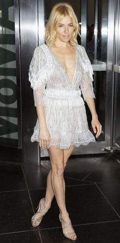 Sienna Miller sizzled at the New York premiere of Burnt in a flirty LWD treated with dainty lace frills, an illusion panel, and embroidered sequins. The finishing touch—silver strappy sandals.