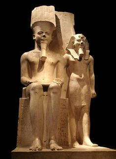 Statue of Pharaoh Horemheb with the god Amun.