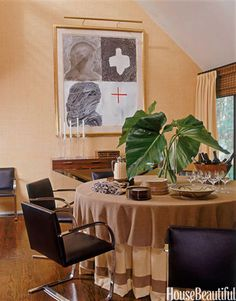 Informal Dining Room - Designer and homeowner Kerry Delrose didn't want a formal dining room, so he skirted the table and uses it for buffets.