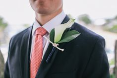 Preppy groom in navy blue suit, pink-coral tie and white calla lily boutonniere {Maine Tinker}