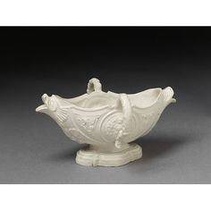 Sauce boat Place of origin:Staffordshire, England (made)Date:ca. 1745 (made)Artist/Maker:unknown (production)Materials and Techniques:Salt-glazed stoneware and moulded