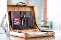 Nisantari's briefcase is absolutely stunning, crafted from real bamboo wood with rich leather accents. Inside, there are compartments for your smartphone, pens, cards, passport, chargers, and a custom foam pad that holds laptops up to 13. Also available in mahogany.