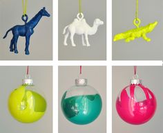 love this: buy clear ornaments and drip gold paint into them and shake them up!