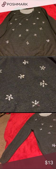 Plus size flower jeweled shirt 3X This is a long sleeved plus size shirt from forever 21- size 3X. It has these pretty crystals/jewels on them in the shape of a flower all over the shirt. Super cute for the upcoming holiday season :-) Forever 21 Tops Tees - Long Sleeve