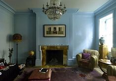 Courtney Love's federal brick home in the West Village, New York. A Frances Bacon triptych hangs above the mantel; the globe to the left of the fireplace belonged to Kurt Cobain.