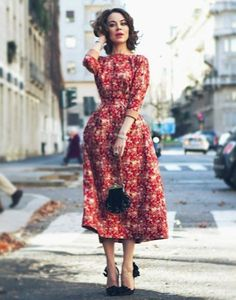 Red Floral 3/4 sleeve dress. The back is even greater.  Ulyana Sergeenko
